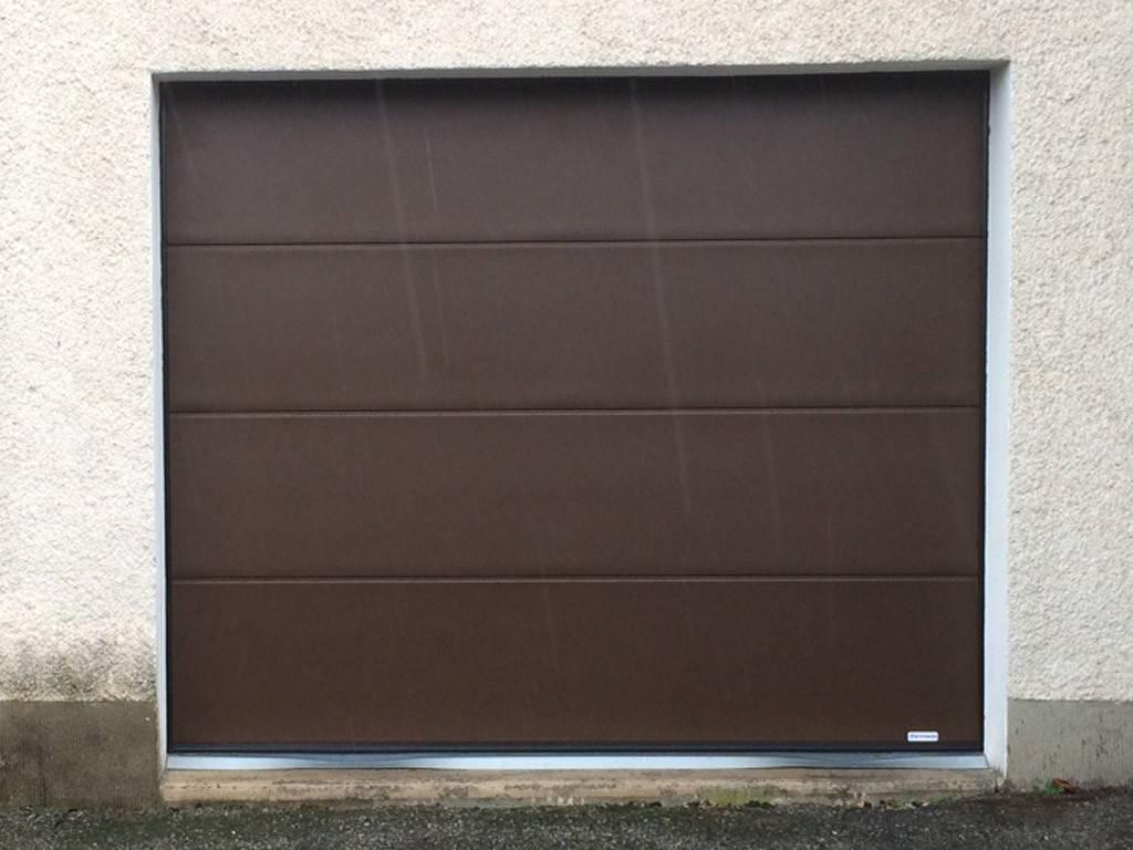 Porte de garage poisat 38 tryba alpes bati confort for Porte de garage sectionnelle tryba